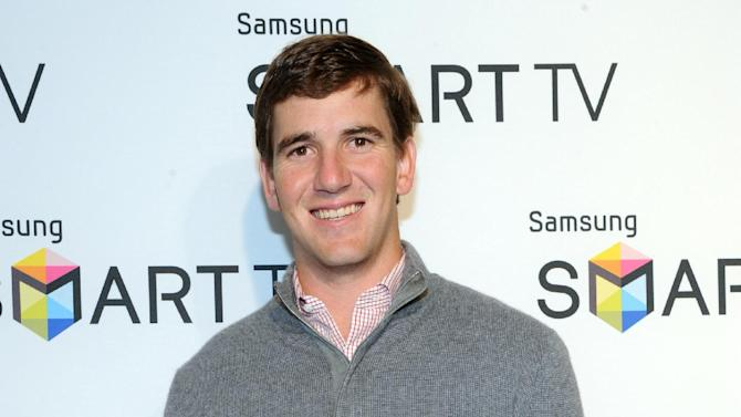 Eli Manning helps Samsung showcase its 2013 line of Smart TVs, Wednesday, March 20, 2013, in New York.  Samsung's new line allows the viewer to discover more of the TV they love with a smarter and more personalized experience.  (Photo by Diane Bondareff/Invision for Samsung/AP Images)