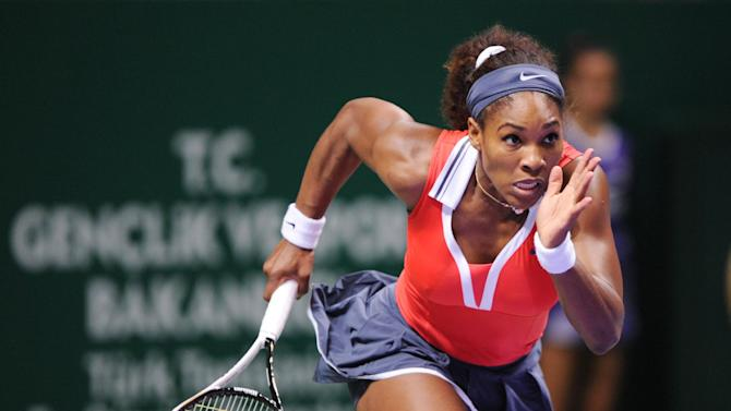 Serena Williams of the U.S. runs to return a shot to Maria Sharapova of Russia during their tennis match on the final of the WTA Championships in Istanbul, Turkey, Sunday, Oct. 28, 2012. (AP Photo)