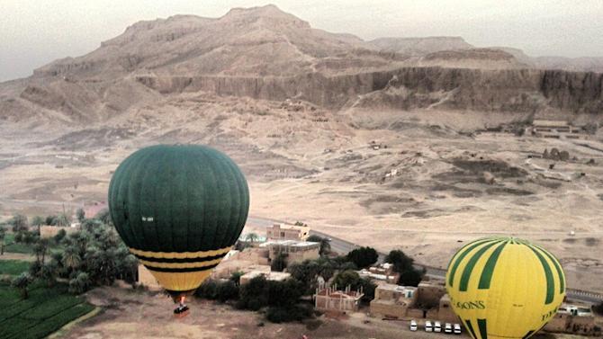 In this image made available by Christopher Michel, the launch site near Luxor in Egypt, shortly prior to a hot air balloon explosion which killed at least 18 tourists including a number of tourists Tuesday Feb. 26, 2013. Witnesses described hearing a loud explosion before seeing plumes of smoke as the balloon caught fire and plunged into a sugar cane field west of Luxor, which is 320 miles (510km) south of the capital Cairo. The casualties are believed to include British and French tourists, as well as other nationalities, a security official in the country said. (AP Photo/Christopher Michel)