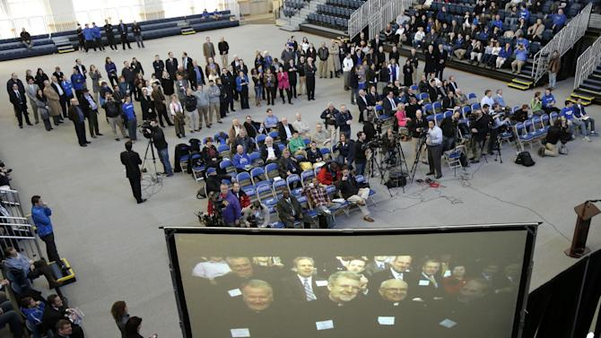 Creighton fans in Omaha, Neb., Wednesday, March 20, 2013, watch a telecast of a news conference from Madison Square Garden in New York, announcing that Butler, Creighton and Xavier are moving to the new Big East. They will join the so-called Catholic 7 basketball schools who left to start a new conference and are keeping the Big East name. (AP Photo/Nati Harnik)