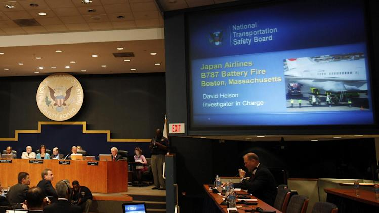 David Helson, National Transportation Safety Board (NTSB) Investigator in Charge, seated right, speaks during a hearing investigating a battery fire aboard a Boeing 787, Tuesday, April 23, 2013, at the NTSB in Washington. Also pictured are Boeing Commercial Airplanes Vice President and Chief Project Engineer Mike Sinnett, seated second from left, and NTSB Chairman Deborah Hersman, top third from left. (AP Photo/Charles Dharapak)