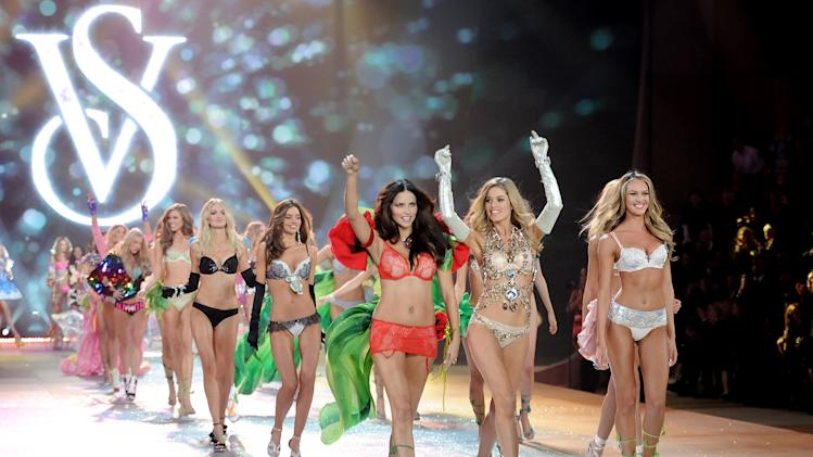 Models Adriana Lima, left, Doutzen Kroes and Candice Swanepoel, right,  lead the final runway walk during the 2012 Victoria's Secret Fashion Show on Wednesday Nov. 7, 2012 in New York. The show will be broadcast on Tuesday, Dec. 4 (10:00 PM, ET/PT) on CBS. (Photo by Evan Agostini/Invision/AP)