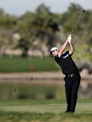 England&#39;s Justin Rose plays a shot during the second round of the Abu Dhabi Golf Championship at the Abu Dhabi Golf Club in the Emirati capital on January 18, 2013. Rose was the leader at the halfway stage at eight under par after a 69