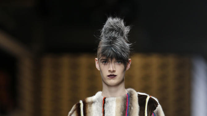 A model wears a creation of Fendi women's Fall-Winter 2013-14 collection, part of the Milan Fashion Week, unveiled in Milan, Italy, Thursday, Feb. 21, 2013. (AP Photo/Luca Bruno)