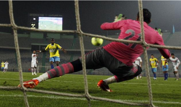 Mahmoud Gennesh goalkeeper of El Zamalek catches the penalty kick from John Antwi of El Ismaily during their opening Egyptian Premier League derby soccer match at Cairo Stadium