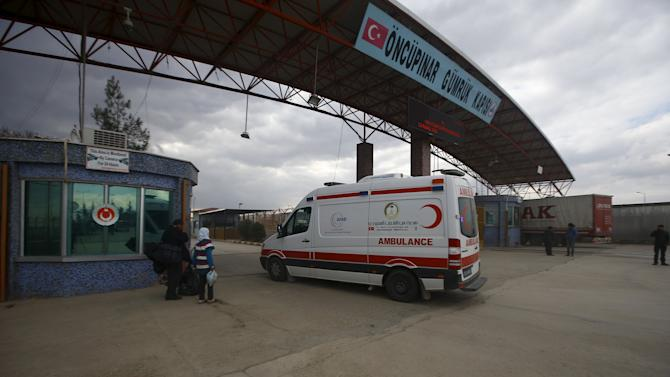 Ambulance enters Syria from Turkey at Turkey's Oncupinar border crossing on the Turkish-Syrian border in the southeastern city of Kilis