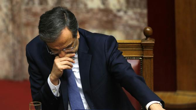 Greek Prime Minister Samaras reacts in parliament during the last round of a presidential vote in Athens
