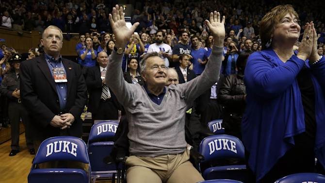 Former President George H.W. Bush is introduced during the first half of an NCAA college basketball game between Duke and North Carolina State at Cameron Indoor Stadium in Durham, N.C., Saturday, Jan. 18, 2014