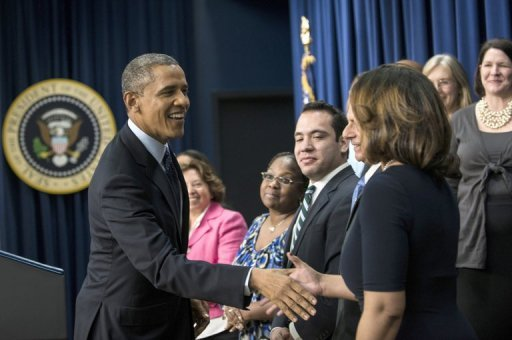 "<p>US President Barack Obama greets invited guests before making a statement about fiscal cliff negotiations from the White House December 31, 2012. The White House and top Republicans struck a deal to avert huge New Year tax hikes and spending cuts known as the ""fiscal cliff"" that had threatened to send the US economy into recession.</p>"