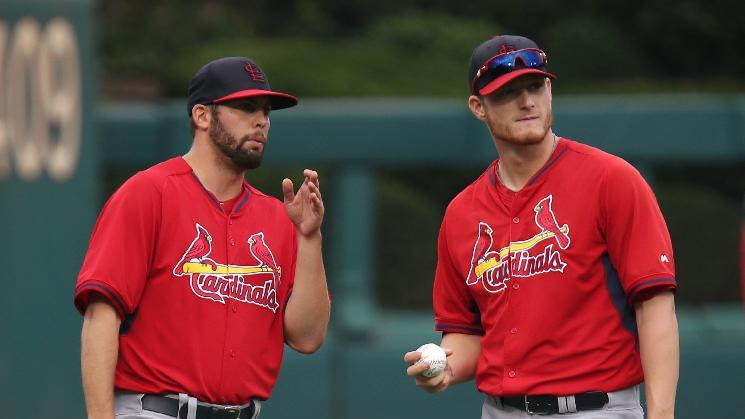 St Louis Cardinals' Nick Greenwood, left, and Shelby Miller chat in warmups before a baseball game with the Philadelphia Phillies, Friday, Aug. 22, 2014, in Philadelphia. (AP Photo/Laurence Kesterson)