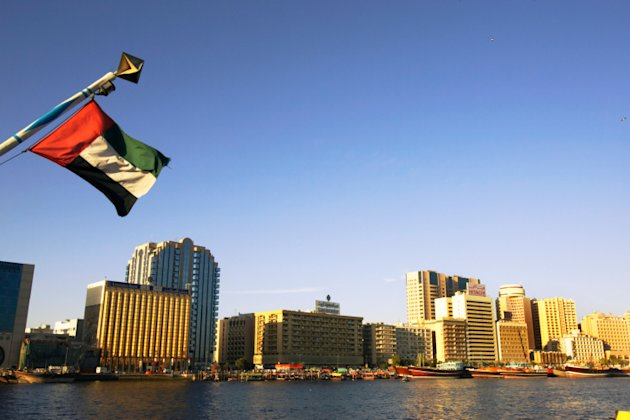 United Arab Emirates, Dubai, Bastakia, Dubai Creek, flag in foreground