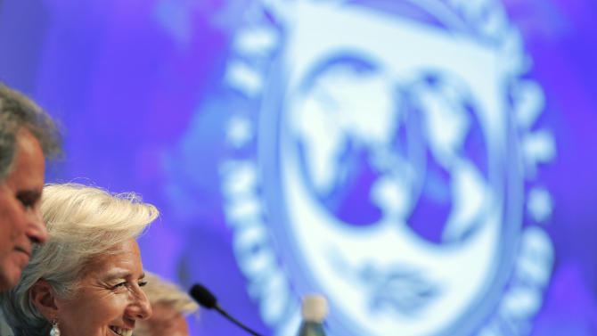 International Monetary Fund (IMF) chief Christine Lagarde, second left, attends a news conference at the IMF and World Bank's annual general assembly in Tokyo, Thursday, Oct. 11, 2012. (AP Photo/Itsuo Inouye)
