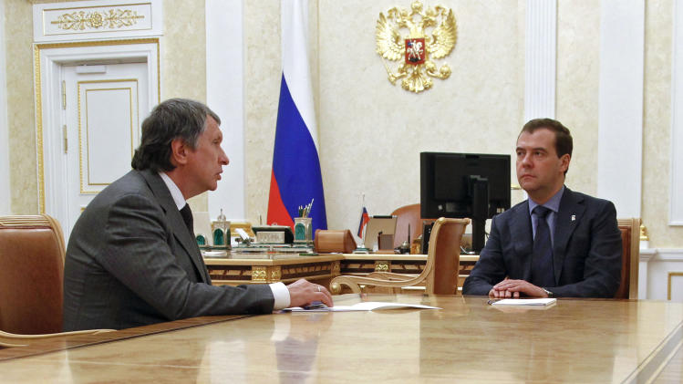 Russian Prime Minister Dmitry Medvedev, right, meets with Igor Sechin, appointed as CEO of state-controlled Russian oil company Rosneft, in Moscow, Tuesday, May 22, 2012. (AP Photo/RIA-Novosti, Dmitry Astakhov, Presidential Press Service)