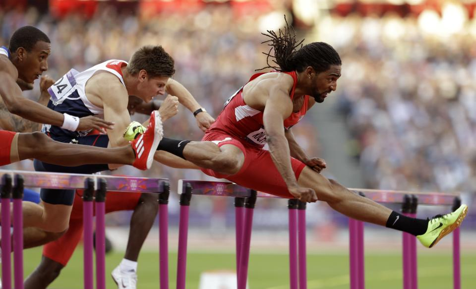 United States' Jason Richardson leads Cuba's Orlando Ortega and Britain's Lawrence Clarke during their men's 110-meter hurdles semifinal during the athletics in the Olympic Stadium at the 2012 Summer Olympics, London, Wednesday, Aug. 8, 2012. (AP Photo/Ben Curtis)