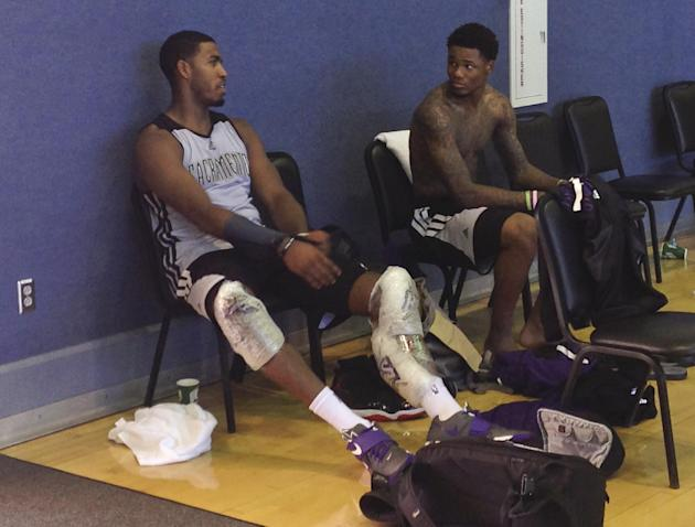 Sacramento Kings forward Jason Thompson, left, speaks with rookie guard Ben McLemore after the NBA basketball team's first practice of training camp, Tuesday, Oct. 1, 2013, in Santa Barbara, Calif. Th