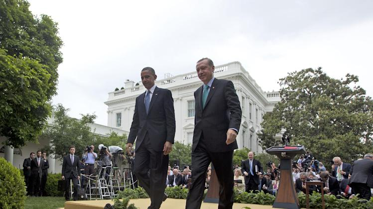 President Barack Obama and Turkish Prime Minister Recep Tayyip Erdogan walk away from the podiums following their joint news conference in the Rose Garden of the White House in Washington, Thursday, May 16, 2013. (AP Photo/Pablo Martinez Monsivais)