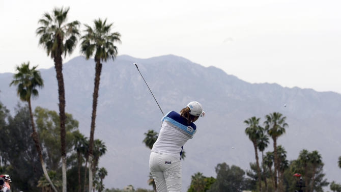 Inbee Park, of South Korea, watches her tee shot on the fifth hole during the final round of the LPGA Kraft Nabisco Championship golf tournament in Rancho Mirage, Calif., Sunday, April 7, 2013. (AP Photo/Chris Carlson)