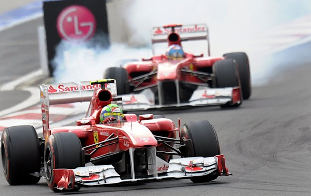 Ferrari driver Felipe Massa of Brazil (front) powers his car ahead of his teammate Fernando Alonso of Spain during the Formula One Korean Grand Prix in Yeongam on October 16, 2011. Massa finished in s