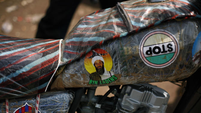 A Bin Laden sticker adorns the tank of a small motorcycle in Mopti,  some 630 kms (400 miles)  north of Mali's capital  Bamako Thursday, Jan. 24, 2013.  One wing of Mali's Ansar Dine rebel group has split off to create its own movement, saying that they want to negotiate a solution to the crisis in Mali, in a declaration that indicates at least some of the members of the al-Qaida-linked group are searching for a way out of the extremist movement in the wake of French airstrikes. (AP Photo/Jerome Delay)