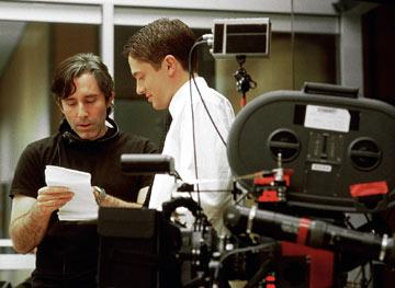 Writer/director Paul Weitz and Topher Grace on the set of Universal Pictures' In Good Company