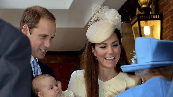 Britain's Prince William carries his son Prince George, as he arrives with his wife Catherine, Duchess of Cambridge for their son's christening at St James's Palace in London