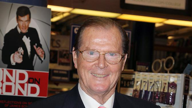 """FILE - This Nov. 9, 2012 file image released by Starpix shows British actor Roger Moore at a signing for his book, """"Bond On Bond: Reflections on 50 years of James Bond Movies,"""" at Barnes and Noble in New York. Moore's recollections are cheeky and well informed. He includes snapshots of famous pals who showed up on set, details gadgetry and includes a great color beefcake shot of Daniel Craig. Moore, who was one of six actors who portrayed the super spy James Bond 007, starred in the films, """"Live and Let Die,"""" """"A View to a Kill,"""" """"Octopussy,"""" """"Moonraker,"""" """"The Man with the Golden Gun,"""" """"For Your Eyes Only,"""" and """"The Spy Who Loved Me.""""  (AP Photo/Starpix, Amanda Schwab)"""
