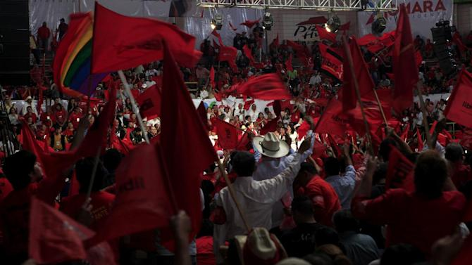 In this June 16, 2013 photo, people attend the Free Party's convention where Xiomara Castro, wife of ousted President Manuel Zelaya, is their presidential candidate in Tegucigalpa, Honduras. Polls show Castro, 53, leading seven other candidates ahead of the Nov. 24 election, including the military general who conducted the coup against Zelaya in June 2009. (AP Photo/Alberto Arce)(AP Photo/Alberto Arce)