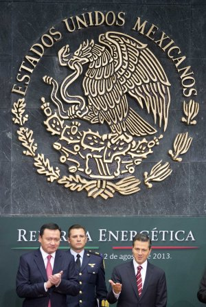 Mexico's President Enrique Pena Nieto, right, greets …