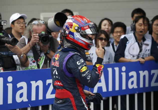 Red Bull Formula One driver Vettel gestures after taking pole position for the qualifying session of the Korean F1 Grand Prix in Yeongam