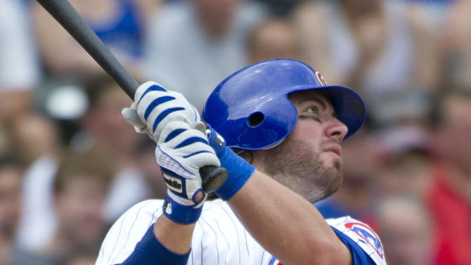 Chicago Cubs third baseman Ian Stewart follows through on a two-run home run scoring Alfonso Soriano during the fourth inning of a baseball game against the San Diego Padres, Monday, May 28, 2012 in Chicago.  (AP Photo/Brian Kersey)