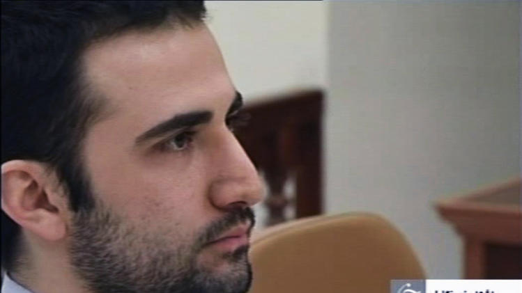 In this Tuesday, Dec. 27, 2011 video frame grab image made from the Iranian broadcaster IRIB TV, U.S. citizen Amir Mirzaei Hekmati, accused by Iran of spying for the CIA, sits in Tehran's revolutionary court, in Iran. An Iranian court has convicted Hekmati and sentenced him to death, state radio reported Monday, Jan. 9, 2012. Iran charges that Hekmati received special training and served at U.S. military bases in Iraq and Afghanistan before heading to Iran for his alleged intelligence mission. (AP Photo/IRIB, File)  NO ACCESS IRAN;  BBC PERSIAN TV OUT; VOA PERSIAN TV OUT