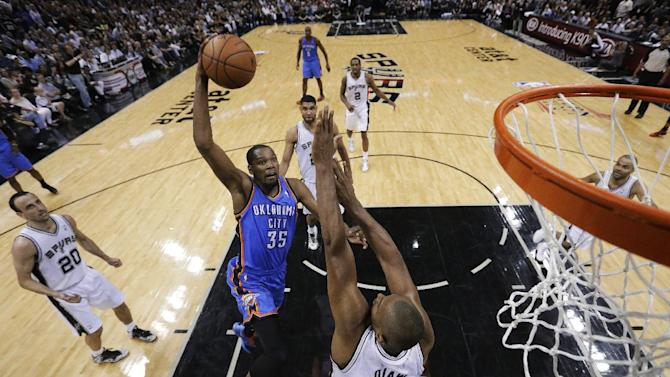 Oklahoma City Thunder's Kevin Durant (35) shoots over San Antonio Spurs' Boris Diaw (33), of France, during the first half of Game 5 of the Western Conference finals NBA basketball playoff series, Thursday, May 29, 2014, in San Antonio