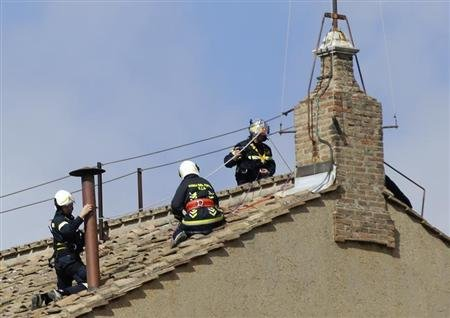 Members of the fire and rescue service set a chimney on the roof of the Sistine Chapel at the Vatican March 9, 2013. REUTERS/Max Rossi