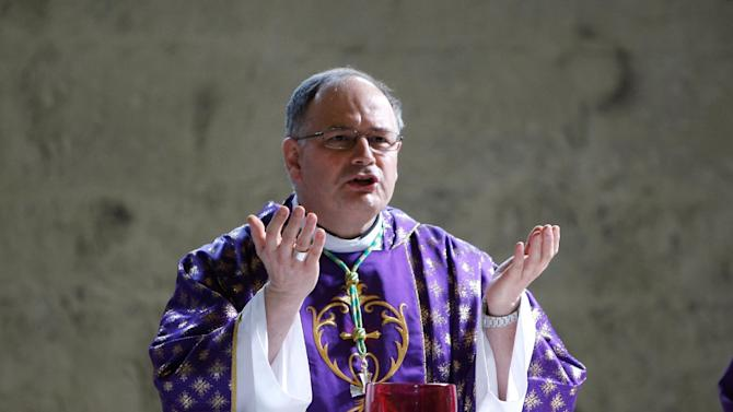 Jean-Philippe Nault, Bishop of Digne celebrates a mass in homage to  the victims of he Germanwings jetliner crash, inside the cathedral Notre Dame de Bourg, in Digne, French Alps, Saturday, March 28, 2015. The crash of Germanwings Flight 9525 into an Alpine mountain, which killed all 150 people aboard, has raised questions about the mental state of the co-pilot. Authorities believe the 27-year-old German deliberately sought to destroy the Airbus A320 as it flew Tuesday from Barcelona to Duesseldorf. (AP Photo/Claude Paris)