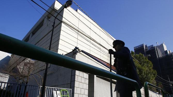 "A Japanese police officer stands in front of the headquarters of the pro-Pyongyang General Association of Korean Residents in Japan, in Tokyo, Monday, Feb. 8, 2016.  The U.N. Security Council condemned North Korea's launch of a long-range rocket that world leaders called a banned test of ballistic missile technology and another ""intolerable provocation."" The U.N.'s most powerful body pledged to quickly adopt a new resolution with ""significant"" new sanctions. (AP Photo/Shizuo Kambayashi)"
