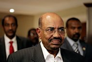Sudan's President Omar al-Bashir walks in a hotel in Addis Ababa on September 24 where he met with his South Sudanese counterpart Salva Kiir. Sudan and South Sudan reached agreements on a demilitarised border zone and oil production but made limited progress on contested areas, their officials said late Wednesday