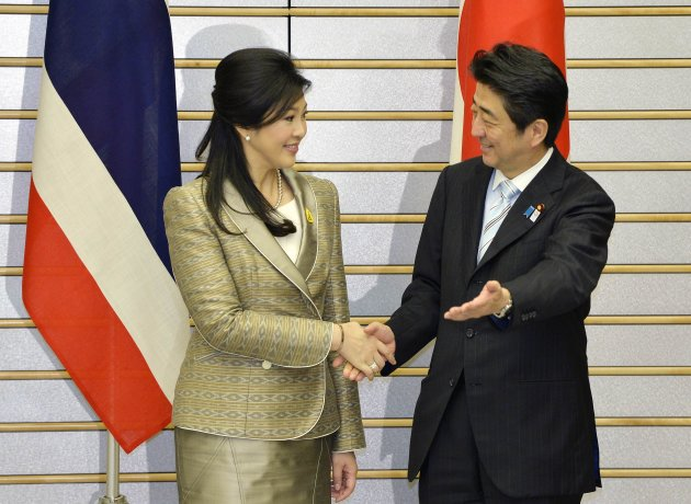 Thai PM Yingluck is welcomed by her Japanese counterpart Abe at the start of their meeting at Abe's official residence in Tokyo