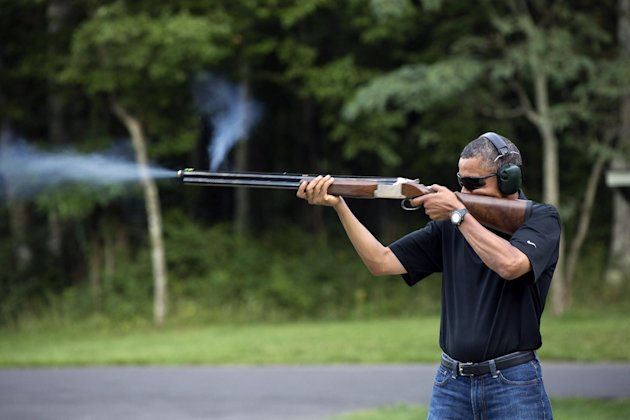 In this photo released by the White House, President Barack Obama shoots clay targets on the range at Camp David, Md., Saturday, Aug. 4, 2012. The White House released a photo of Obama firing a gun, two days before he heads to Minnesota to discuss gun control. In a recent interview with The New Republic magazine, Obama said yes when asked if he has ever fired a gun. He said &quot;we do skeet shooting all the time,&quot; except for his daughters, at Camp David. (AP Photo/The White House, Pete Souza)