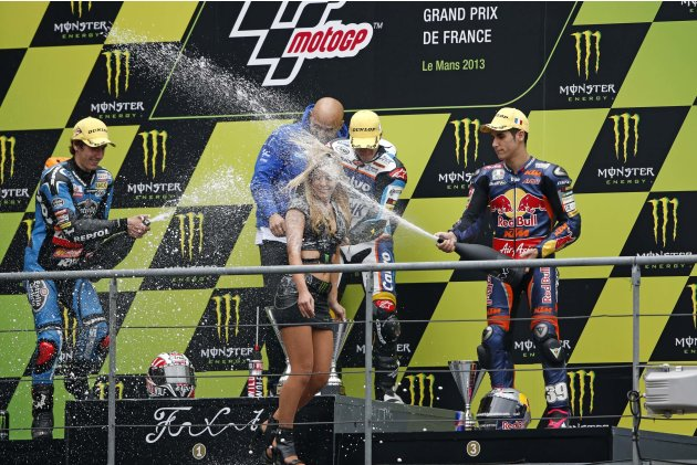 Team Calvo Moto3 rider Vinales of Spain celebrates on podium between KTM's Moto3 rider Rins of Spain and Red Bull KTM Ajo Moto3 rider Salom of Spain after winning the French Grand Prix in Le Mans circ