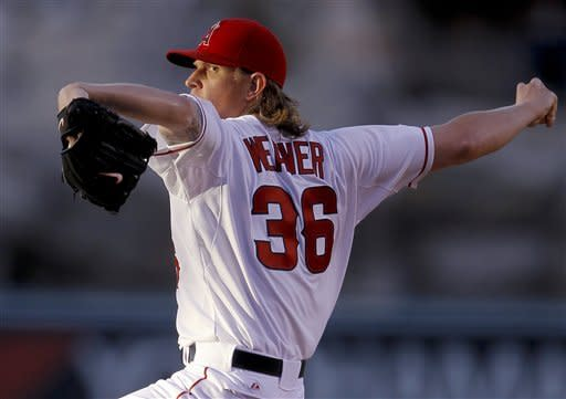 Weaver returns from DL, beats Giants 6-0