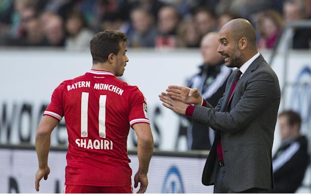 Bayern head coach Pep Guardiola of Spain, right, speaks to Bayern's Xherdan Shaqiri of Switzerland during the German Bundesliga soccer match between VfL Wolfsburg and Bayern Munich inWolfsburg, Ge