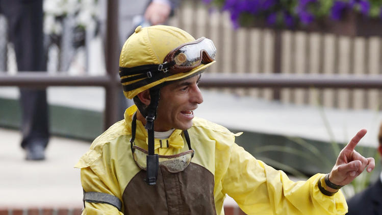 Jockey John Velazquez smiles aboard Union Rags after their win in the Belmont Stakes horse race at Belmont Park in Elmont, N.Y., on Saturday, June 9, 2012. (AP Photo/Mike Groll)