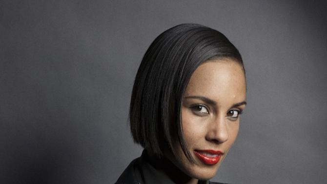"""In this Nov. 26, 2012 photo, musician and actress Alicia Keys poses for a portrait in promotion of her fifth album """"Girl on Fire,"""" in New York.  Keys cut her hair this summer and is now sporting a bob. And she says she """"actually wants to go even shorter"""" in an interview last week. The 31-year-old came on the music scene in 2001 with braids, and has mostly worn her hair long. But she says with her new haircut, she's able to do more with her hair. (Photo by Victoria Will/Invision/AP)"""