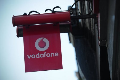 <p>Mobile phone giant Vodafone on Tuesday revealed it had slumped into a net loss of £1.977 billion during its first half on massive writedowns linked to indebted eurozone countries Spain and Italy</p>