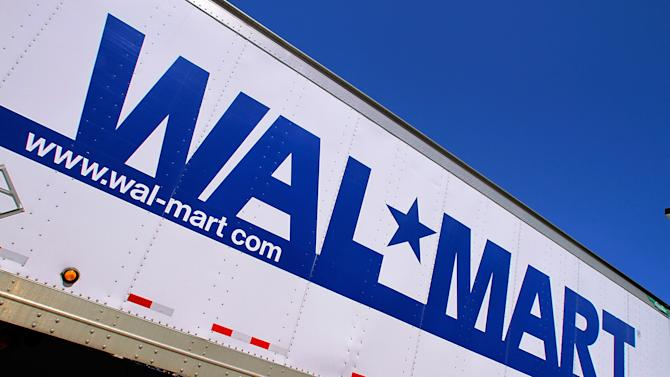 FILE - In this May 16, 2011 file photo, the Wal-Mart logo is displayed in Springfield, Ill. The world's largest retailer is throwing its doors open at 8 p.m. on Thanksgiving Day, two hours earlier than a year ago. It's also guaranteeing shoppers that it will have three of the most popular items it sells if they line up inside the store during a one-hour event that day. AP Photo/Seth Perlman, File)