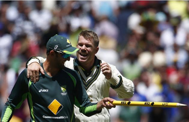 Australia's David Warner celebrates with Nathan Lyon after winning the fourth Ashes cricket test against England at the Melbourne cricket ground