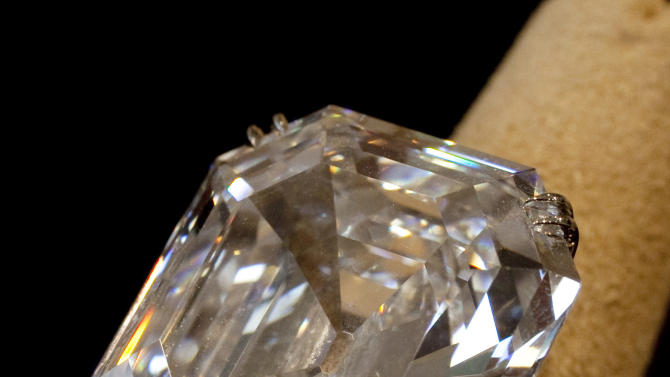 """FILE - This Sept. 1, 2011 file photo shows """"The Elizabeth Taylor Diamond,"""" a 33.19 carat a gift to the actress from Richard Burton at Christie's, in New York. The 33.19-carat diamond ring given to Elizabeth Taylor by actor Richard Burton sold for over $8.8 million at auction in New York Tuesday, Dec. 13, 2011. The ring was purchased in 1968 for $305,000. But diamond experts caution that the average diamond ring bought for a few thousand dollars by a consumer, while it will never be worthless, will not appreciate much if at all in value. (AP Photo/Richard Drew, File)"""