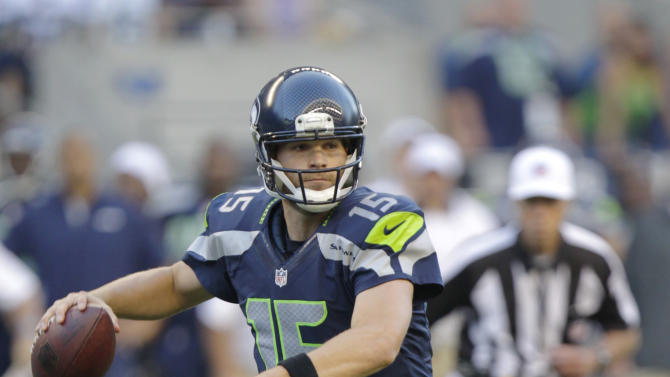 Seattle Seahawks quarterback Matt Flynn looks to pass against the Tennessee Titans in the first half of an NFL football preseason game, Saturday, Aug. 11, 2012, in Seattle. (AP Photo/Rick Bowmer)