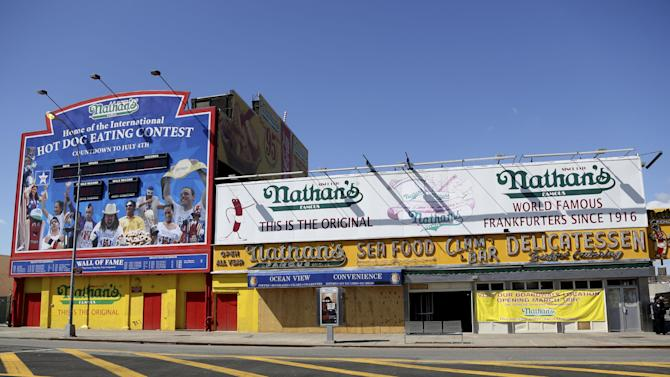 A Saturday March 30, 2013, photo shows the boarded up flagship Nathan's Famous hot dog stand  in New York's Coney Island.  Despite making the traditional Palm Sunday opening, many of the seasonal businesses at Coney Island are still reeling from the aftermath of Superstorm Sandy. (AP Photo/Mary Altaffer)