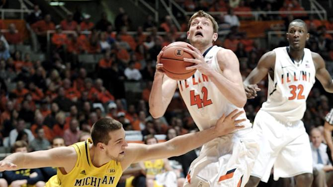 Illinois' Tyler Griffey (42) grabs a loose ball and goes back to the basket as Michigan's Mitch McGary (4) tries to recover during the first half of an NCAA college basketball game, Sunday, Jan. 27, 2013, in Champaign, Ill. (AP Photo/John Dixon)